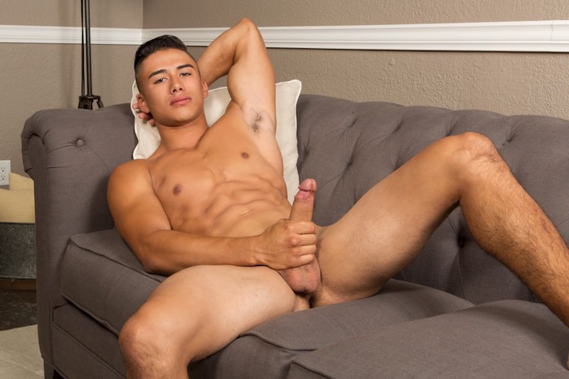 Jock wanking his thick uncut cock on the couch