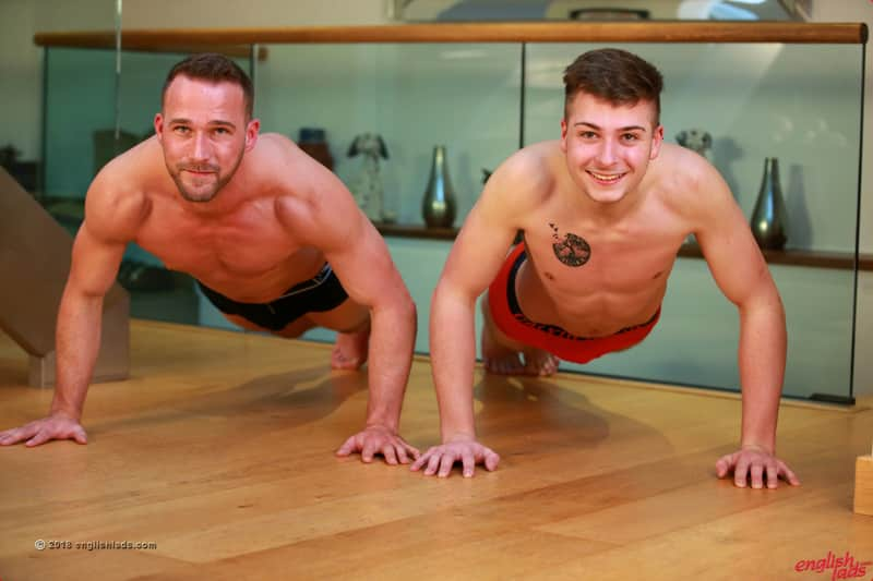 two horny straight guys working out together in a gay porn shoot