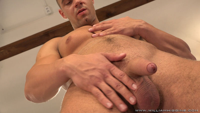 Arny Donan stroking some cum from his uncut cock 5