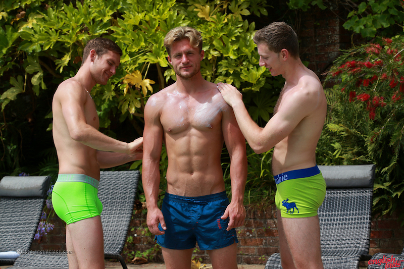 Muscular straight guy Aaron Janes lets Joel Jenkins and Andrew Hayden rub sun ceam into his shoulders and chest