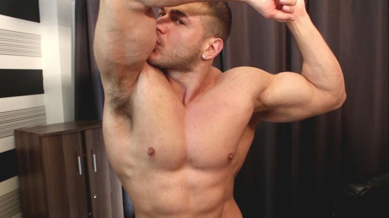 Bodybuilder kissing his bicep