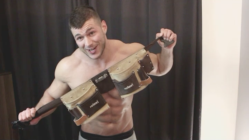 Bodybuilder Joshua Armstrong holding his tool belt in a new jack off video