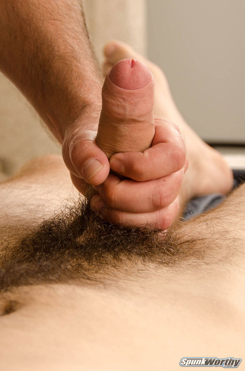 Straight guys uncut cock being jerked off by another guy for the first time