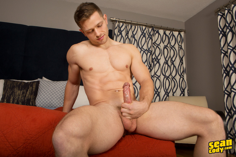 Horny jock Deacon wanking his big uncut cock in his debut video for Sean Cody