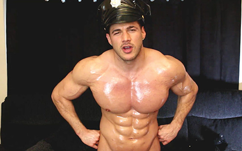 oiled muscle man in a cop jack off video
