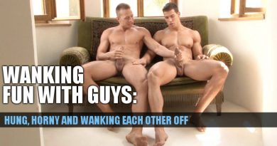Two muscle jocks wanking each other