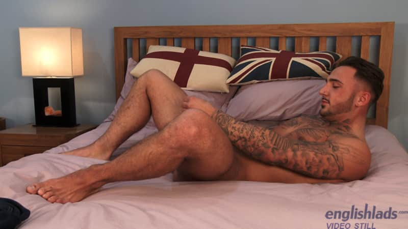 handsome and tattooed straight guy smiling for the camera while stroking his cock