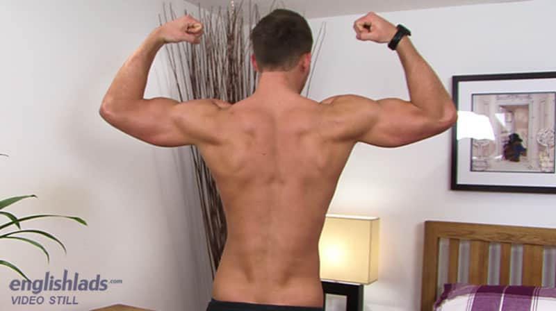 straight guy facing away from the camera while shirtless and flexing his muscles