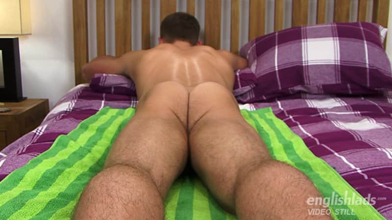 naked straight guy laying face down on a bed and showing his hairy ass