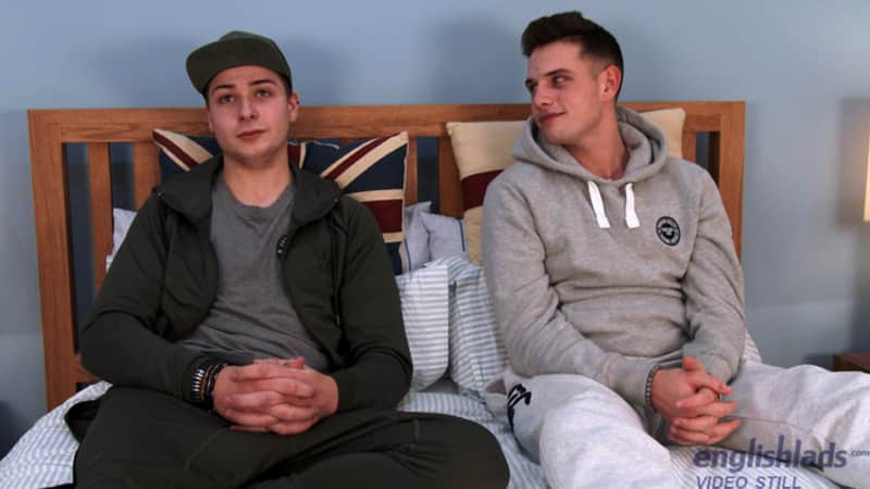 two straight friends sitting on a bed in a gay porn video