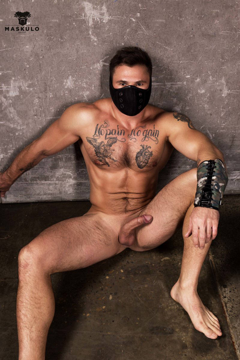 naked muscle jock with a hard cock wearing Maskulo
