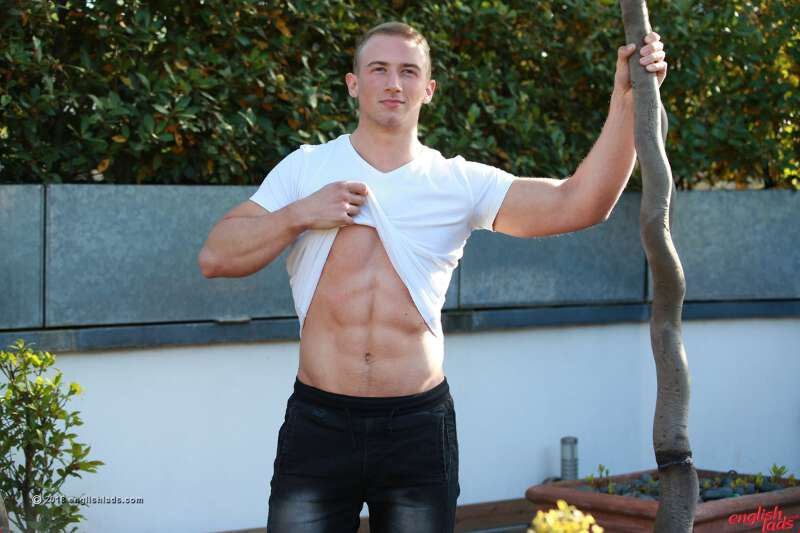 straight jock showing his abs in a jerk off photo shoot