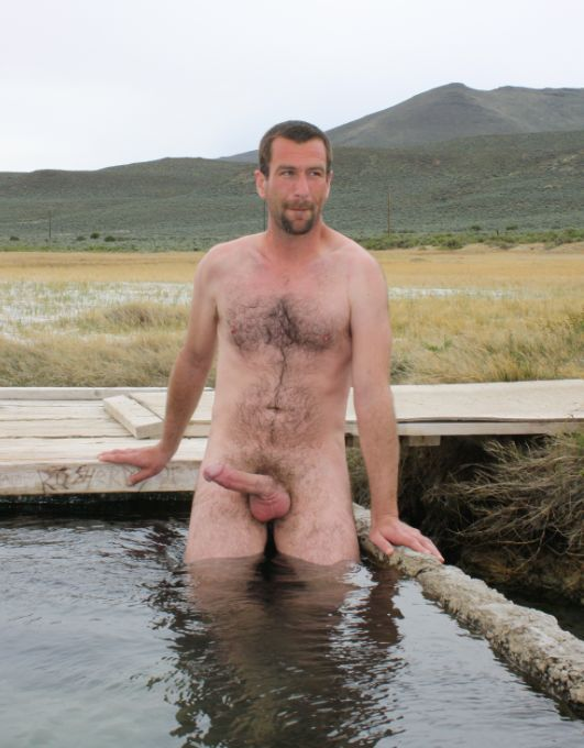 hung and hairy man with a hard cock outside