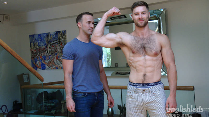 straight jock flexing in front of another straight guy in a wanking video